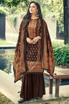 Specifically designed to add a contemporary appeal to your ethnic look, this brown poly-cotton sharara suit will lure the audience like never before. This closed-neck and full sleeve apparel is embellished in digital print work. Teamed up with poly cotton sharara pants in brown color with brown poly-cotton dupatta. Sharara pant is plain. Dupatta designed using digital print work. #trousersuit #salwarkameez #malaysia #Indianwear #Indiandresses #andaazfashion Indian Attire, Indian Wear, Sharara Suit, Salwar Kameez, Ethnic Looks, Trouser Suits, Jacket Style, Indian Dresses, Asian Woman