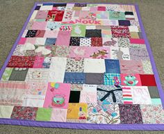 Baby Clothes Quilt - Check out this quilt made entirely out of baby clothes from http://www.jellybeanquilts.com