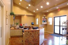 The warm colors, stone floor and recessed lighting greet clients upon entry. A large skylight sits above the reception desk and brightens up Animal Care Hospital in Lafayette, La. - dvm360