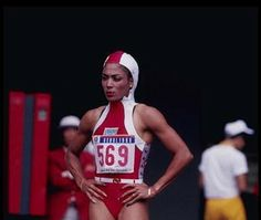 """Florence """"Flo-Jo"""" Griffith-Joyner put sartorial style into women's track events. After demolishing the world record in the 100 m dash at the Olympic Trials in Indianapolis, she set an Olympic record (10.62) in the 100-meter dash and a world record (21.34) in the 200-meter dash to capture gold medals in both events."""