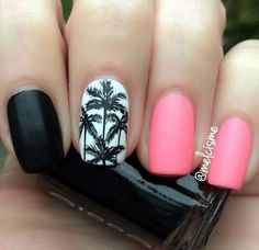 Simplistic Palm Tree Nail Art design. Matte pink and black colors are used on the other nails while there is a lone nail with white background wherein the palm trees are painted in black. Simple but truly mesmerizing.