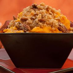 An easy and delicous sweet potato souffle recipe topped with pecans.. Sweet Potato Souffle Recipe from Grandmothers Kitchen.