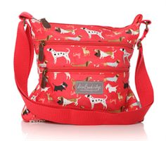 2015 Shruti Walkies Oilcloth Crossbody Bag Red £28.00 (inc VAT) Product code: 1268 The Walkies Oilcloth Cross-body bag from Shruti.  Designed by Lisa Buckridge. Blue with mutiple favourite dogs, zip top, adjustable blue canvas strap, external zip pockets and lined with internal zip and mobile 'phone pockets. www.melburygallery.co.uk #LisaBuckridge