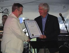 Gov. Rick Snyder (right) presents Bay Harbor Co. David Johnson with a written proclamation paying tribute to the upscale Bay Harbor resort on its 20th anniversary.  #PetoskeyArea  http://www.PetoskeyArea.com
