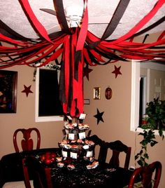 """Originally posted as a """"Twilight Party"""" I think the red and black would work very well in a Night Circus party, plus I really like what they did with the streamers."""