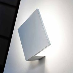 This chic wall and ceiling light Puzzle by Studio Italia Design is made of metal and available in white. The light-fixture is composed of square and rectilinear metallic plates and generates a minimalist modern accent lighting. Indirect Lighting, Flush Lighting, Chandelier Lighting, Modern Lighting, Led Wand, Italia Design, Wall Lights, Ceiling Lights, Puzzle