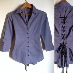 Feathers Gray Button Down Lace Up Shirt Blouse Brand: Feathers Size: Medium Color: Gray  This top is beautiful and in pristine condition. It is a button down shirt and feature 3/4 length sleeves. Although from the front it looks like just an ordinary shirt, it is anything but. The back features an overlay lace up design which ends where your natural arch does.   No trades. Please refrain from asking. Feathers Tops Button Down Shirts