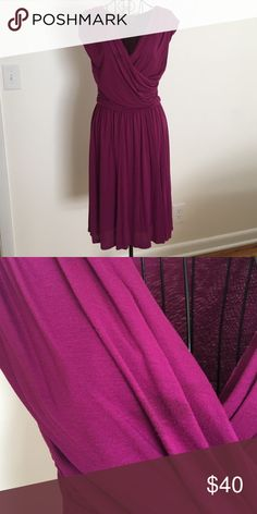 Velvet faux wrap knit dress Anthropologie M Velvet is the brand, not the fabric. 50% Rayon 50% polyester faux wrap front knit dress purchased at Anthropologie. Super soft and drapey knit. Skirt is two layers. High quality. Gorgeous color. Worn once to a wedding. There is a spot on the front that is disguised in the creases of the wrapped portion (see close up photo). Velvet Dresses
