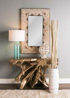 A shell mosaic in a flower petal pattern surrounds this large rectangular beach mirror, perfect for creating a captivating coastal space!  Turquoise Lamp and Driftwood Console table are lovely compliments to this gorgeous hand crafted shell mirror too -