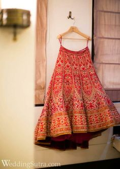 If you are looking for a timeless sophisticated look with a trendy twist for your big day bridal lehengas are a dream. to this red bridal lehenga with heavy zardozi and resham work from Tarun Tahiliani at WeddingSutra on Location. Indian Bridal Lehenga, Indian Bridal Wear, Indian Wedding Outfits, Red Lehenga, Bridal Outfits, Indian Outfits, Anarkali, Lehenga Choli, Lehenga Wedding