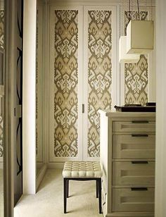 Fabric or wallpaper covered closet doors.