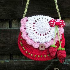 Strawberries put crocheted cherries or strawberries, etc., on purses with that fabric