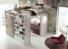 Bed on a platform, loft acting both as a divider and a bookshelf. I just really, really dig this.