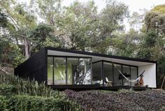 Constructed of steel, glass and concrete, the exteriors are clad in dramatic black with a floor to ceiling glass facade offering views of the valley below from the outdoor lounge area and pool.