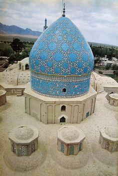 a:      Shrine of Shah Nimatullah Vali, founder of the Nimatullahi Sufi Order, in Mahan, Iran; photograph by Roger Wood, 1969.