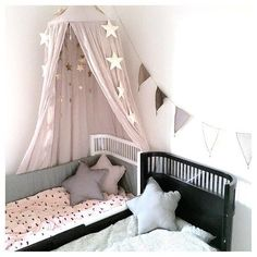 The Powder Pink Número 74 Canopy is styled beautifully in this little girls bedroom