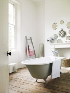 Green and white bathroom, traditional bath, wall of mirrors