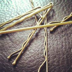 Gold bobby pins.