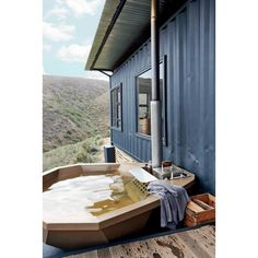 Nothing exudes relaxation like a wood-fired hot tub in the middle of the mountains. This shipping container cabin looks so peaceful! Occupying a hillside on a South African farm, the Copia Luxury Eco Cabins is recycling at its. Shipping Container Cabin, Sea Container Homes, Building A Container Home, Container House Design, Prefab Cabins, Prefab Homes, Eco Cabin, Small Pools, Cabin Design