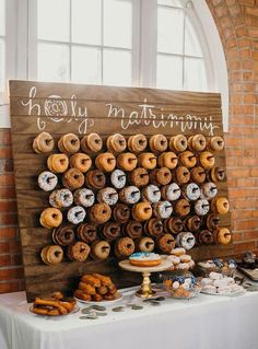 Holy Matrimony! Cute Donut Wedding Food Display and tons of other fun ideas for party food bars and dessert bars. | wedding reception dessert bar | #wedding #dessertbar #desserts #doughnuts