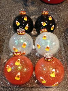 Orange black and white candy corn Halloween themed Christmas ornaments on Etsy, $25.00