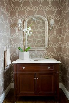 graphic wallpaper small half bath powder room. Taupe, white and brown.