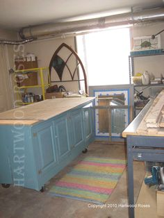 two blocks of cabinets back to back for the worktable