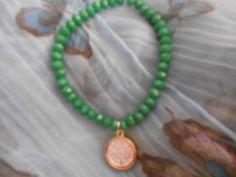 14 Cristal Swarovs & Medalla San Benito $100