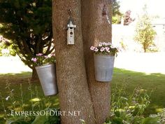 Creative DIY garden container ideas - Old maple syrup bucket planted with flowers