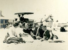 """Family at Jetties Beach, 1906 - A group of people at Jetties Beach, some in bathing suits. Label states: """"Mother in the black suit with white collar, and her sister, Aunt Fan, in all white dress. Fat Aunt Fan never appeared in a bathing suit."""" 1906."""