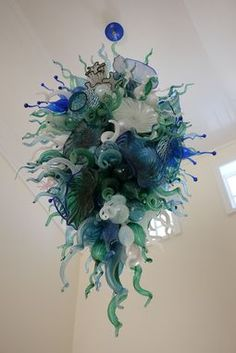 This popular series began with a project for a European client building a second home in South Florida. They commissioned us to design a series of cus… Blown Glass Chandelier, Blown Glass Art, Bronze Sculpture, Cool Lighting, Chandeliers, Stained Glass, Garden Sculpture, Sculptures, Sea