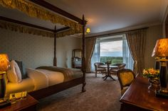 Suite at Glenlo Abbey Hotel.  4 poster beds, luxury linen with Egyptian cotton sheets.  Corrib view bedroom with views overlooking Glenlo Abbey Estate and Lough Corrib.  5 star luxutry hotel in Galway.   www.glenloabbeyhotel.ie