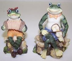 Musical Frogs 2 pack 4in x 2in by Vemars Products. $4.39. Great Patio or Garden Ornament. Very Cute. Resin material Size: 4in H x 2in W Two frogs sitting on tree stumps playing instruments One if female with yellow dress and bow on head Male has bowtie Very colorful. Save 35%!