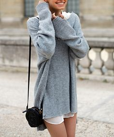 Oversized sweater. Looks comfy. But is she not wearing pants? I would wear pants.