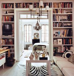 Built-in bookshelf surrounds doorway. #books #bookshelf