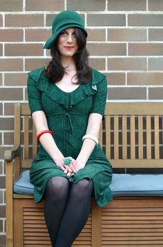 Dee in a green blocked felt cloche with sidesweep detail, 1920s inspired. So beautifully paired with a green dress, red lips and a demure smile.