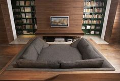 There's one thing every home theater needs, and that's a couch that doubles as a bed of sorts.