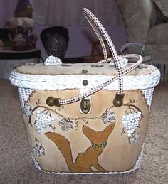 Fabulous Fox and Grapes Midas of Miami purse in tan.