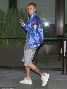 In higher spirits: Justin appeared to be in a good mood as he arrived at Palm Restaurant o...
