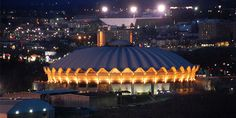 The WVU Coliseum is a 14,000-seat multi-purpose arena which is located in the Evansdale campus of West Virginia University in Morgantown, West Virginia. The circular arena features a poured concrete roof. The arena, which opened in 1970, is home to the WVU Mountaineers men's and women's basketball teams, men's wrestling, as well as WVU's women's teams in volleyball and gymnastics.