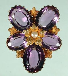 Mid 19th century amethyst and pearl brooch.