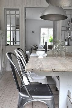 Rustic chic kitchen/dining. Repurposed timber and silver. Tolix chairs are always a winner.