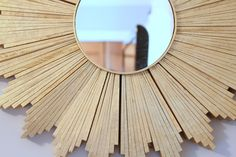 sunburst mirror - I haven't liked many of the DIY sunburst mirrors I have seen, but this one with wood shims is GREAT!!!  MUST DO THIS!!
