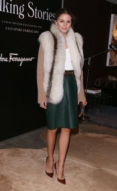 Olivia Palermo added her luxe vest to a forest-green skirt for a perfect holiday outfit.