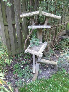A very rustic birdfeeder : )