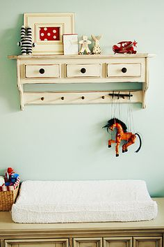 Adorable shelf and love the framed polka dots