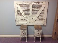 Barn door headboard with matching nightstands.