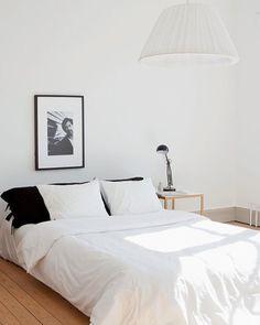 frame over bed, black pillow