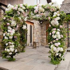 Beautiful and lush floral huppah // photo by: Z MEDIA //  Flowers: HeatherLily Inc. // http://www.theknot.com/weddings/album/a-luxurious-garden-wedding-in-gates-mills-oh-117698