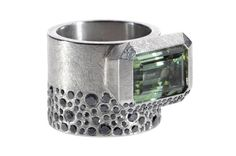Finished in late 2013, Todd Reed's palladium ring features a green tourmaline and black diamonds.